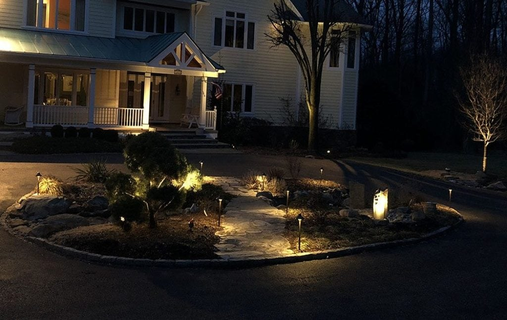 Install outdoor lighting and you can get a circular natural area with path lighting and entryway wall sconce lighting in Silver Springs