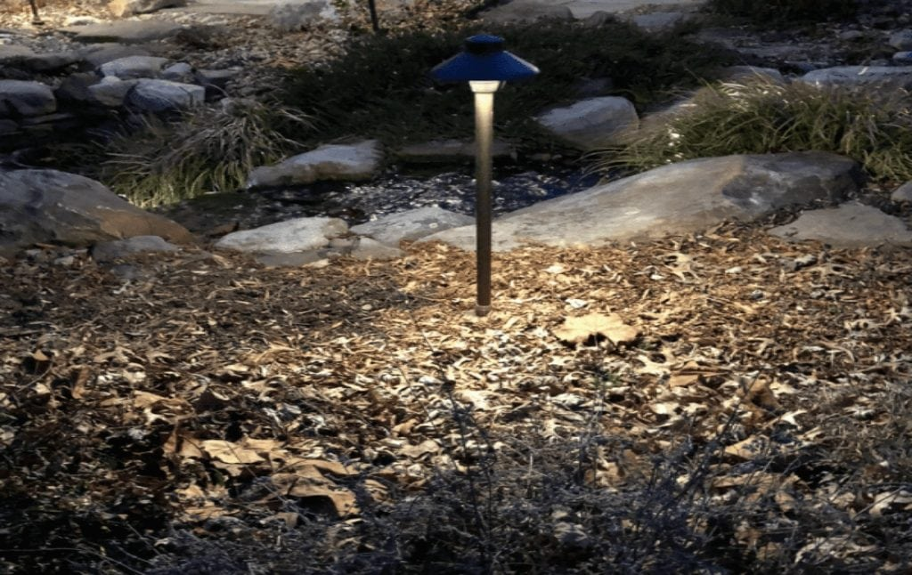 Garden/path light with shield to be dark sky outdoor lighting compliant