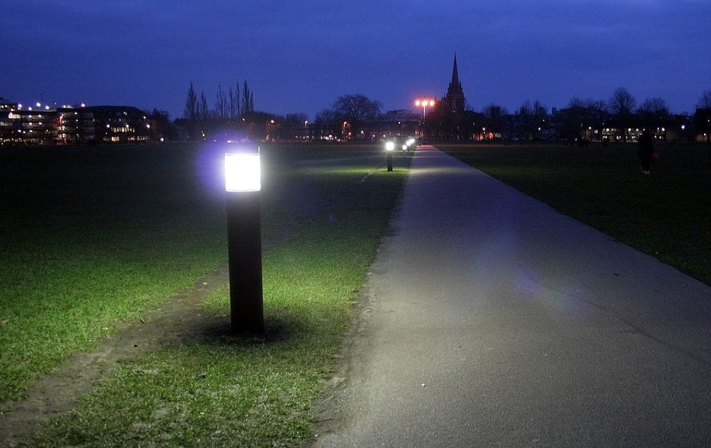 Large bollard fixtures along path