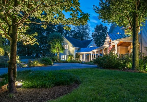 Types of outdoor landscape lighting illuminating this home in Maryland