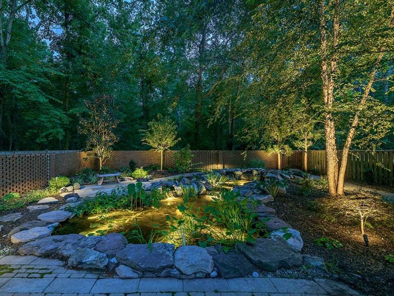 Water feature with underwater LED lights (a 2019 outdoor lighting trend)