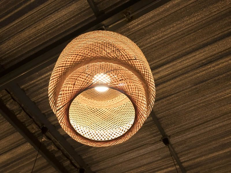Intertwined bamboo light fixture hanging from ceiling