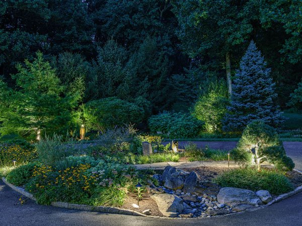 Landscape lighting design with well placed pathway lights