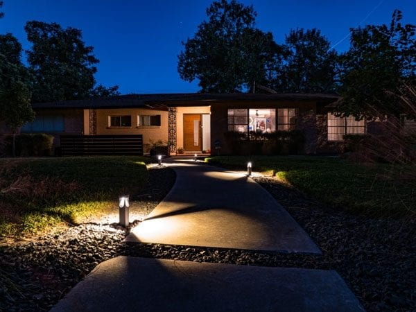 Outdoor walkway lighting ideas include using bollard lights