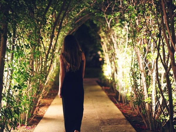 Outdoor walkway lighting ideas can create this fairyland tunnel for your yard