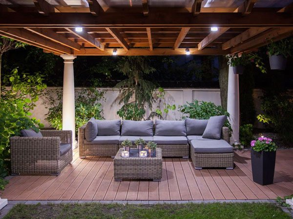 Lighting in a pergola over an outdoor living space